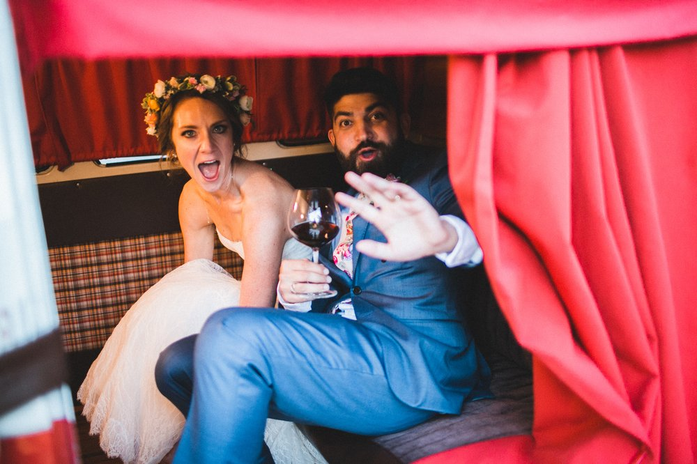 Lauren and Ali taking the photo booth for a spin after exchanging vows! Photo by  Studio Castillero .