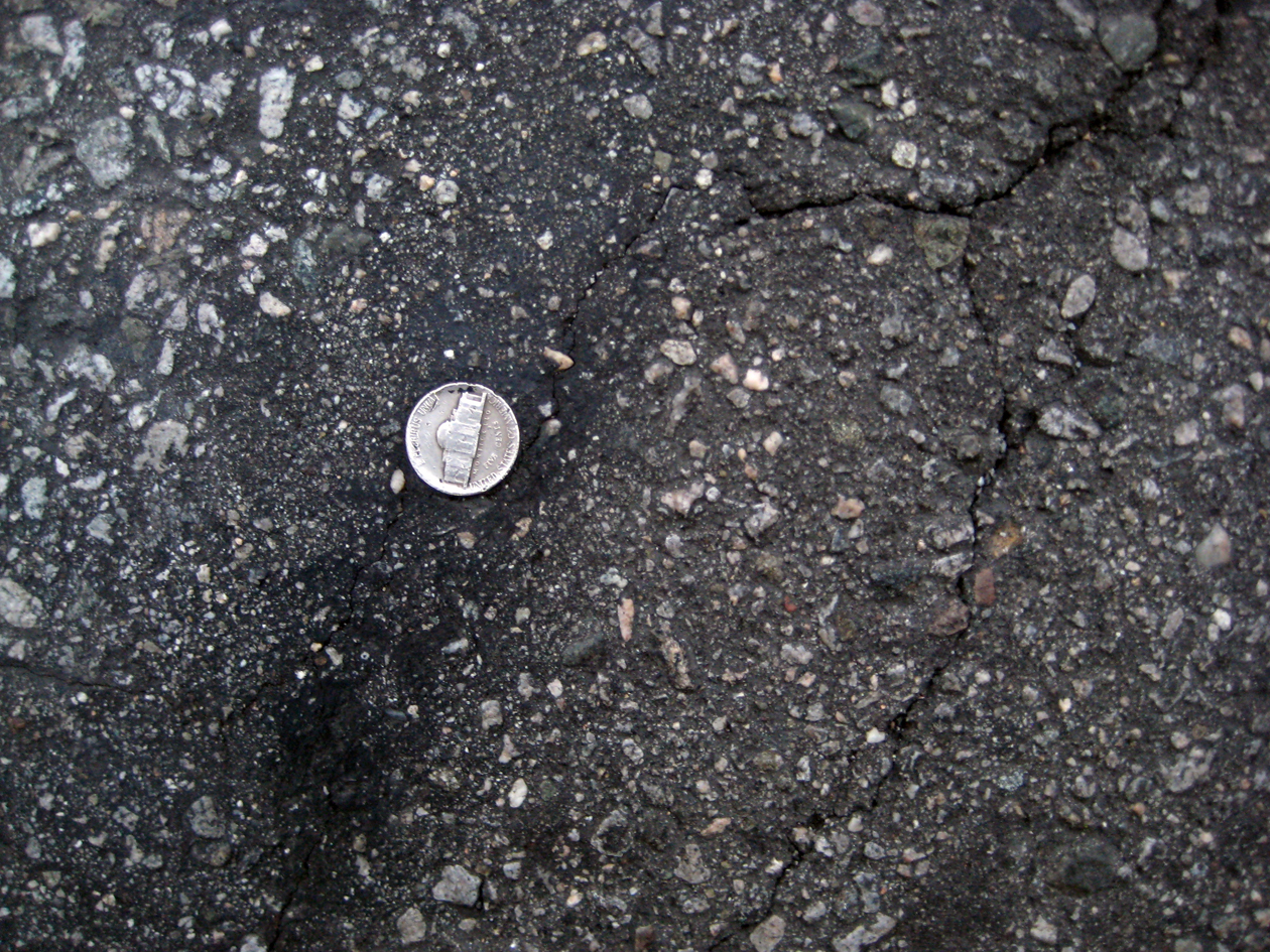 It's rare to find this embedded in the middle of the street. How long had it been there? Is it real? Who put that there? If someone was five cents shy of being able to purchase a meal, looks down and realizes their fate, how'd they feel? Pennys count, but nickels are almost as big as quarters.