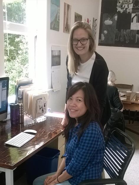 Assistant Director Pamela Grombacher works with Senior Intern Nina Tien.