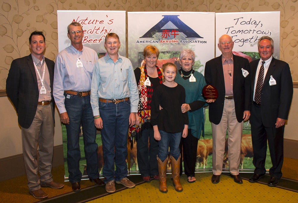 "Selected as the 2013 american akaushi association ""Legacy Award"" recipients were the austin Brown family of beeville, texas. L to r; Jordan Beeman, President of Heartbrand beef, Austin III, Cuatro, Jody, addie, Nana, Austin and Ronald Beeman."