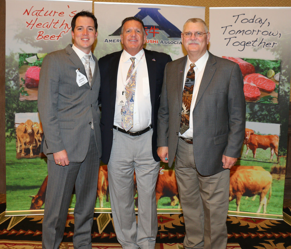 "Jordan Beeman, president of Heartbrand beef, left and Bubba Bain executive director the American akaushi association, right, were proud to present the inaugural ""Prime Plus"" award to Jake Hickton and Bob slane of burger Monger. Jake Hickton of burger monger, center."