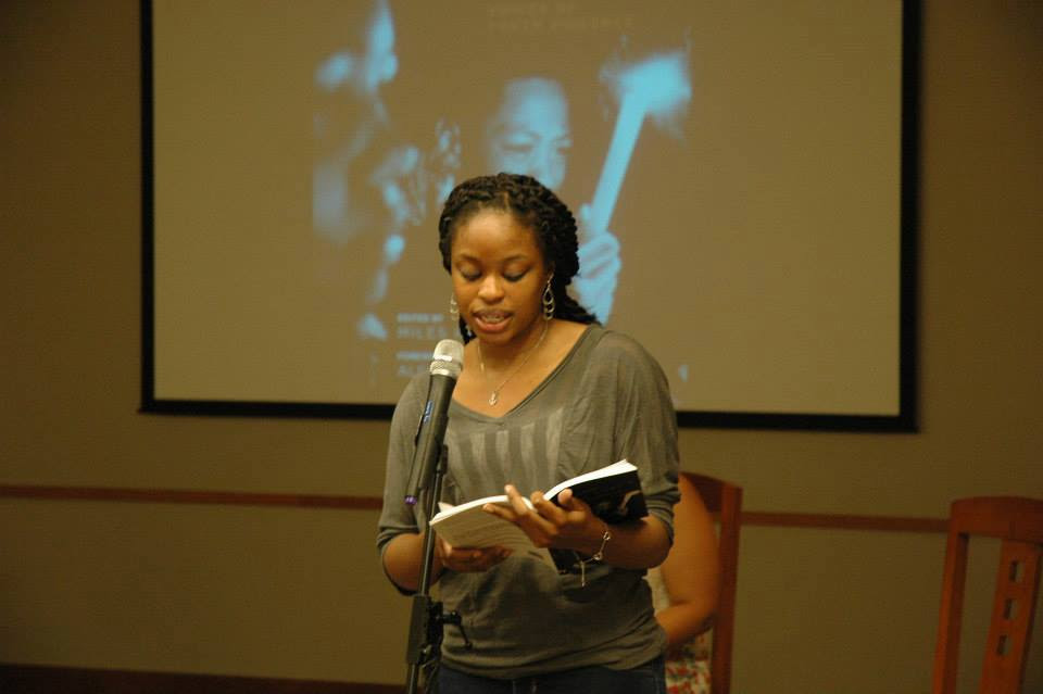 A member of the Teen Loft Troupe reading excerpts from How Long Will I Cry?