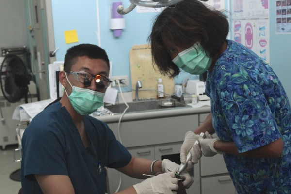 L to R: Dr. James Kim and Canvasback founder and Vice President Jacque Spence work on a dental patient at Majuro Hospital. PC: Brian Hoffman.