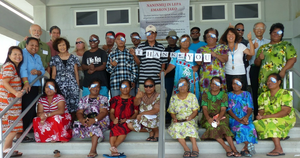 Patients from a single day of cataract surgeries pose on the steps of Ebeye hospital.