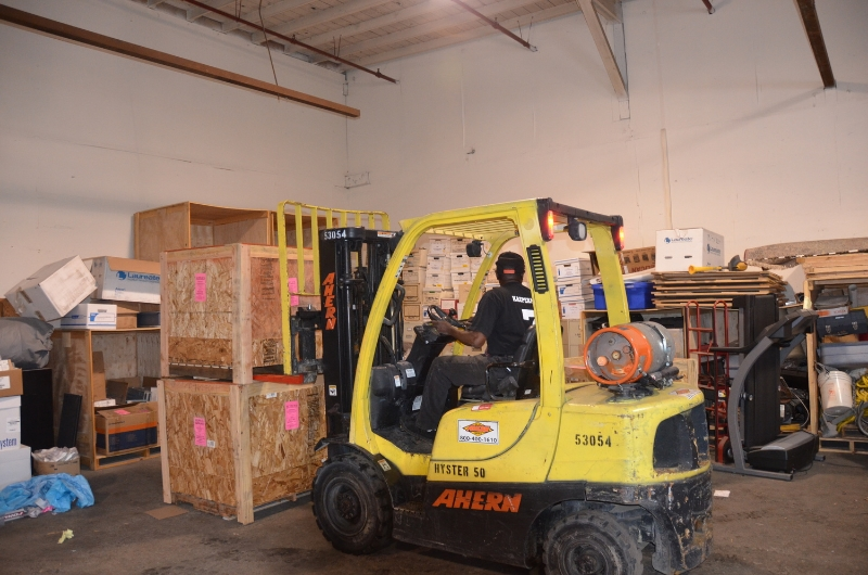 Garland runs the forklift to load our bigger crates.