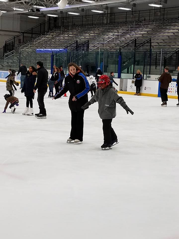 Dallen, in the red helmet, learns to ice skate for the first time only a week after surgery. Photo by Tal Dagan.