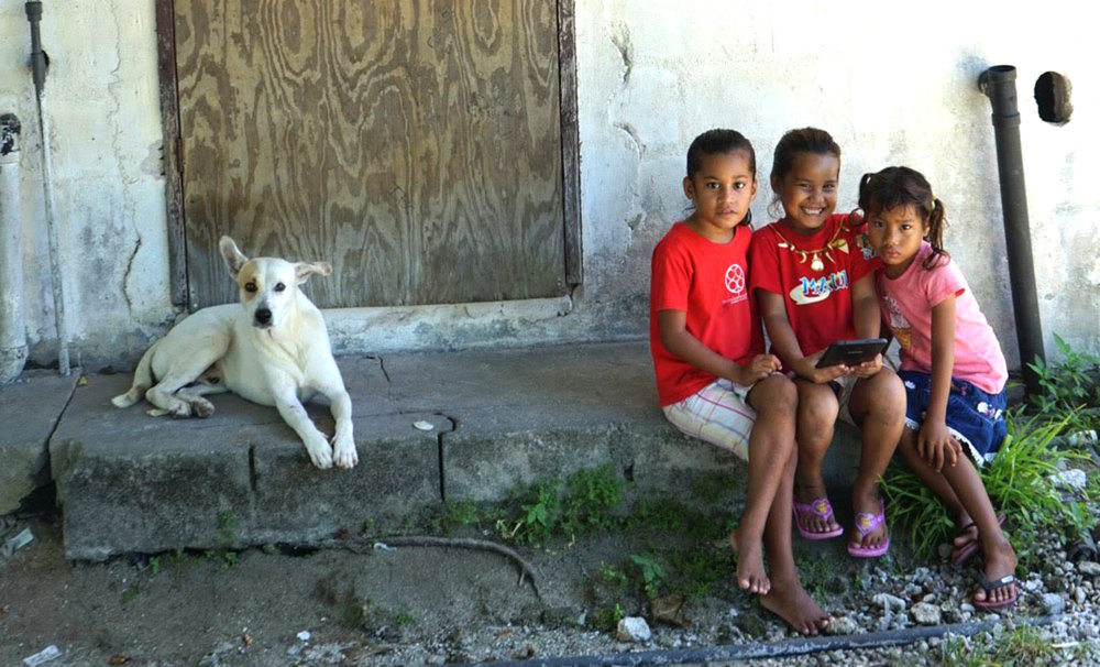 three girls and a dog.jpg