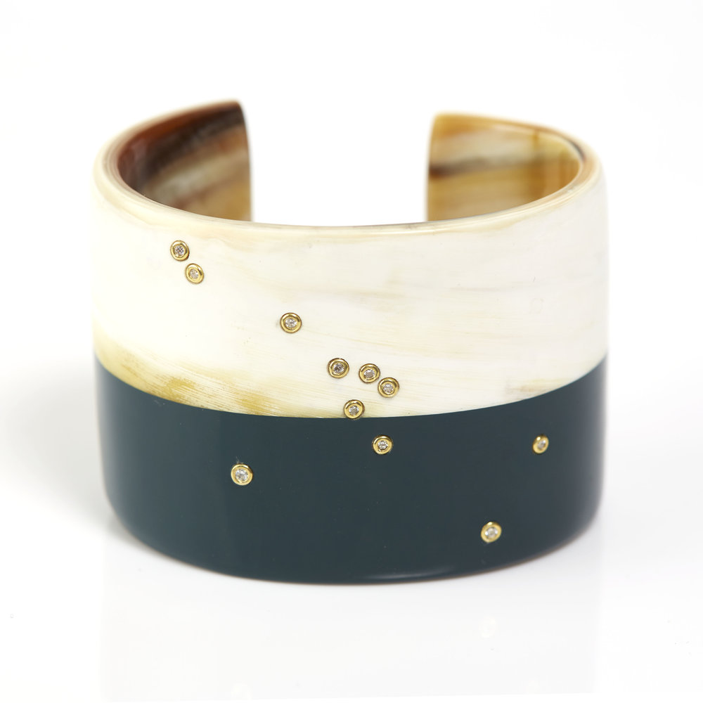 Constellation cuff, shown in natural horn with monsoon lacquer, eleven 18K gold set diamonds. Inquire