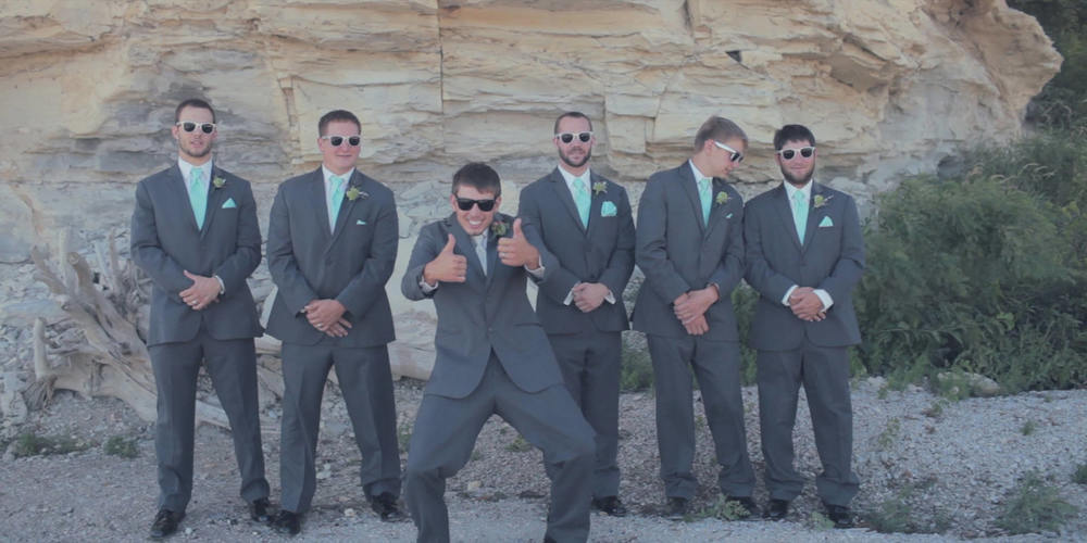 wedding groomsman glasses pose