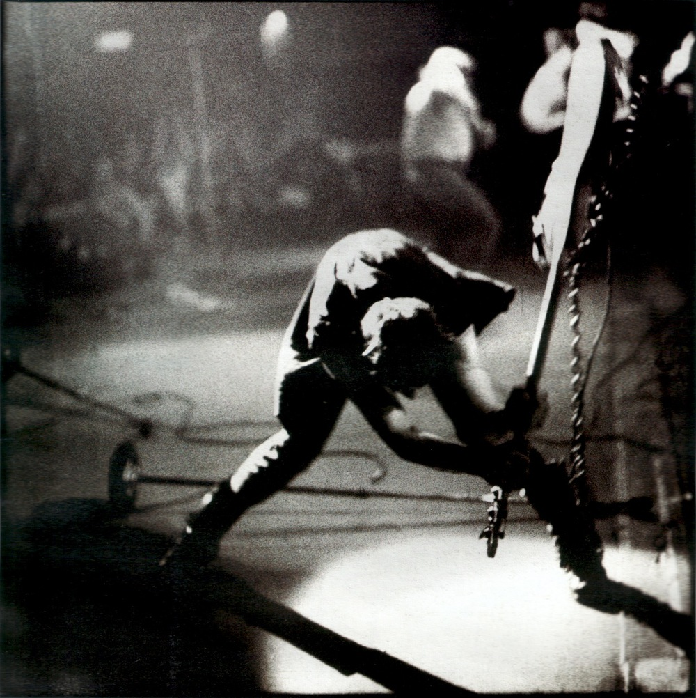 Paul Simonon  by  Pennie Smith  at the New York Palladium in 1979