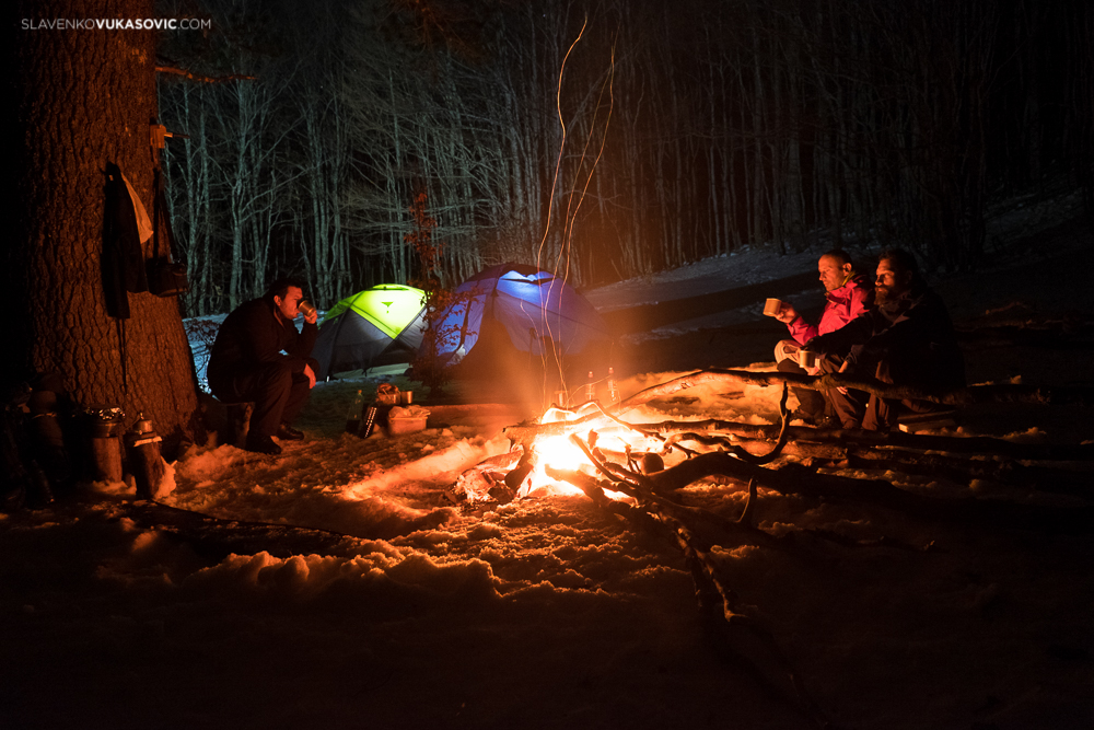 Mountaineers around camp fire - winter camping.jpg