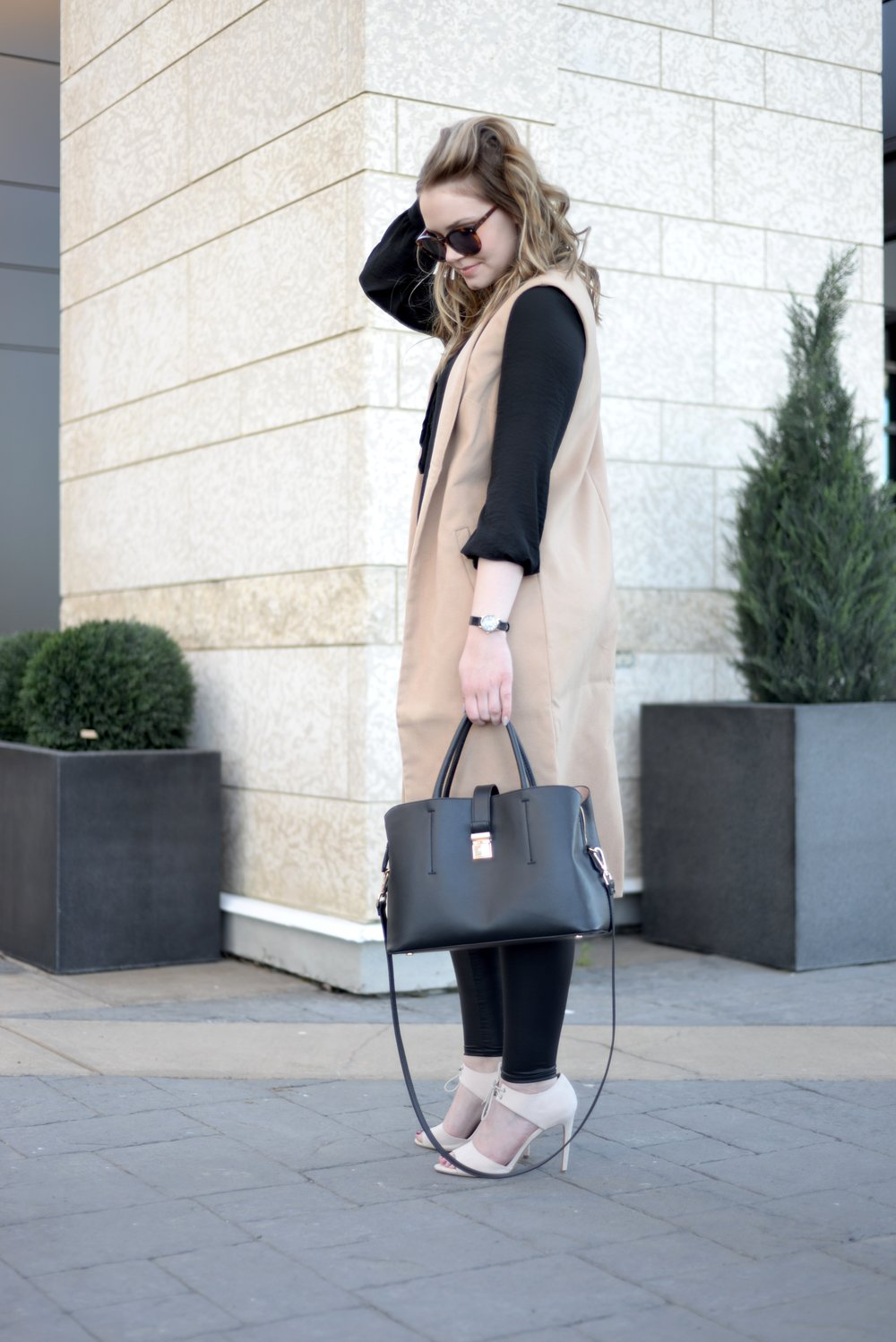 sleeveless vest and leather leggings
