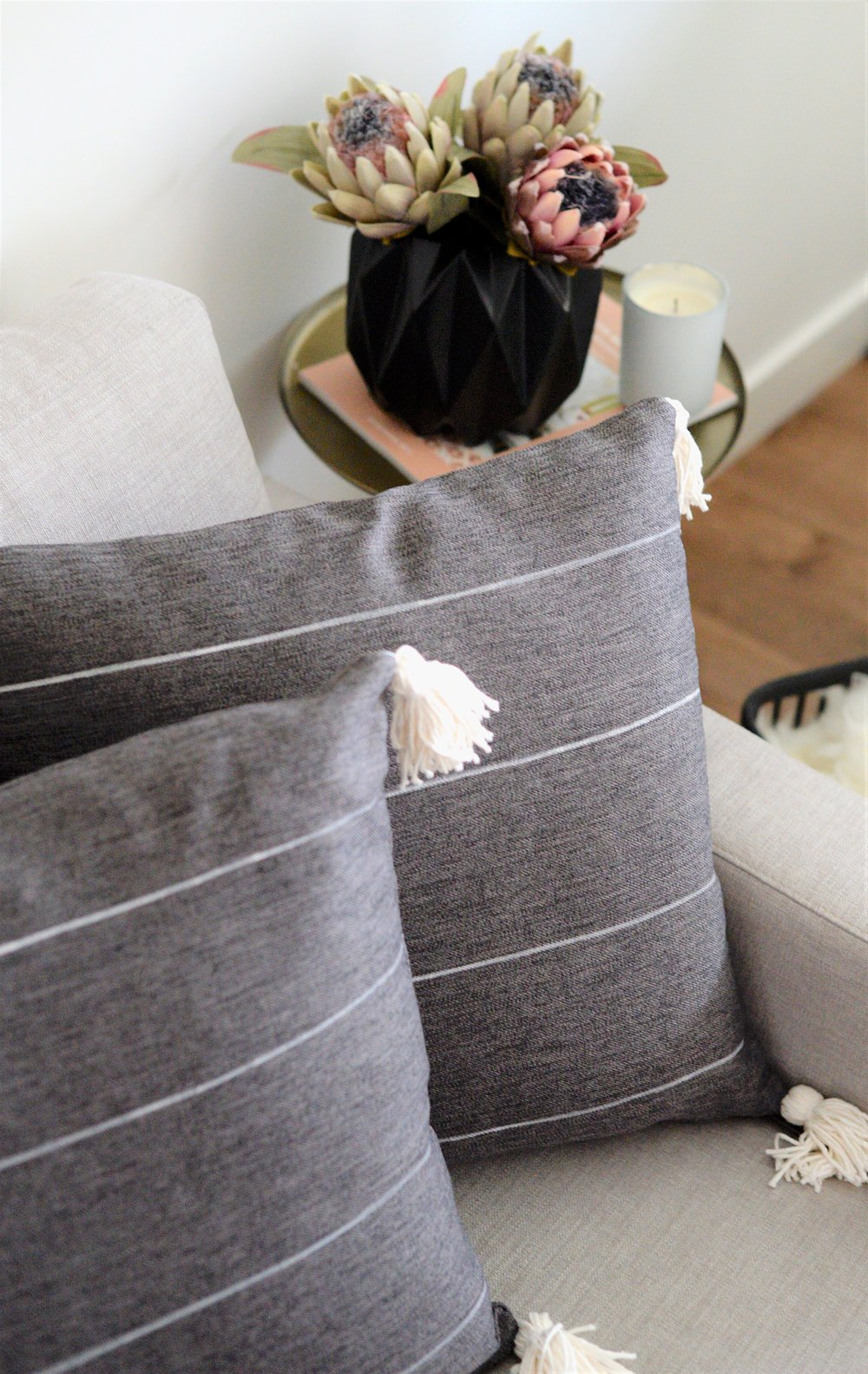 grey striped cushion with tassels - DIY