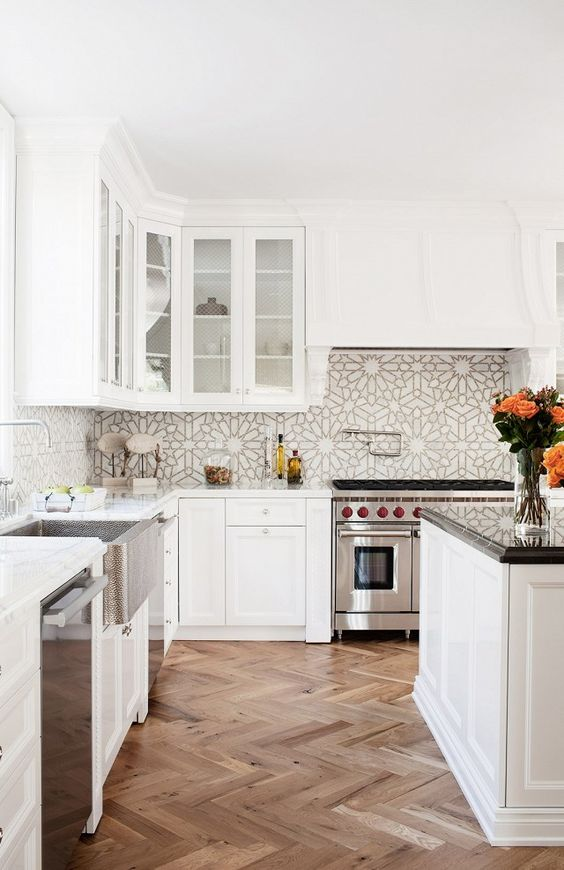 white kitchen, patterned backsplash, herringbone floor