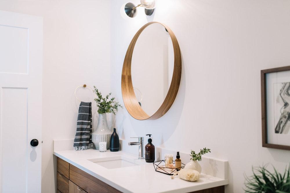 modern bathroom, walnut mirror, cedar and moss light
