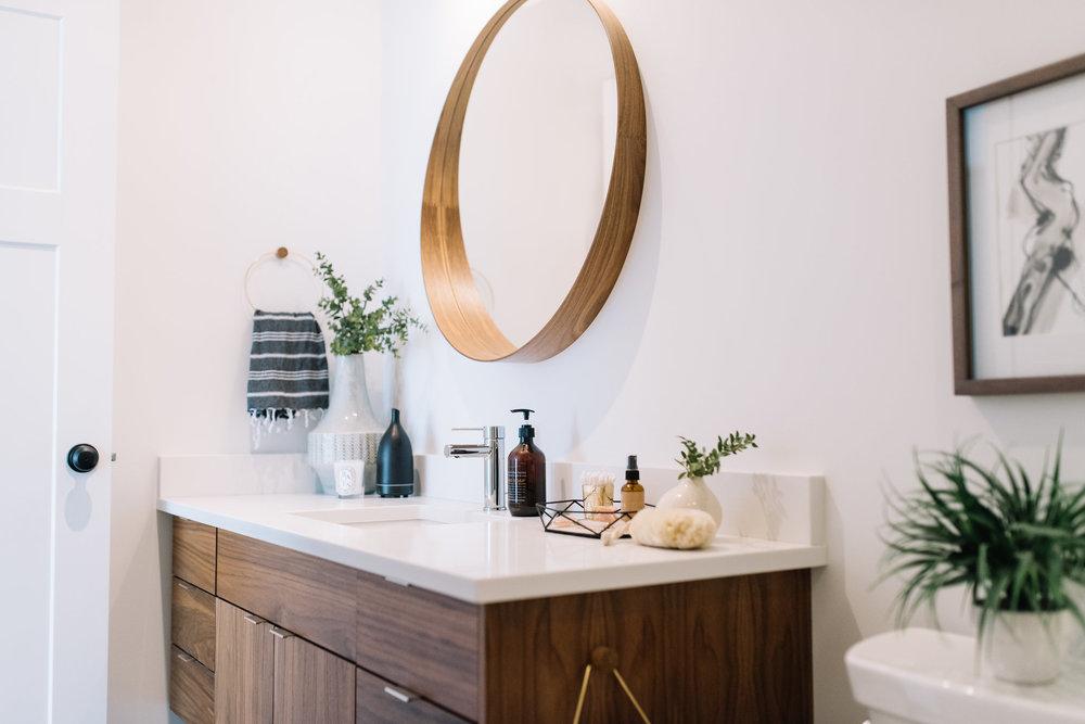 white and walnut washroom
