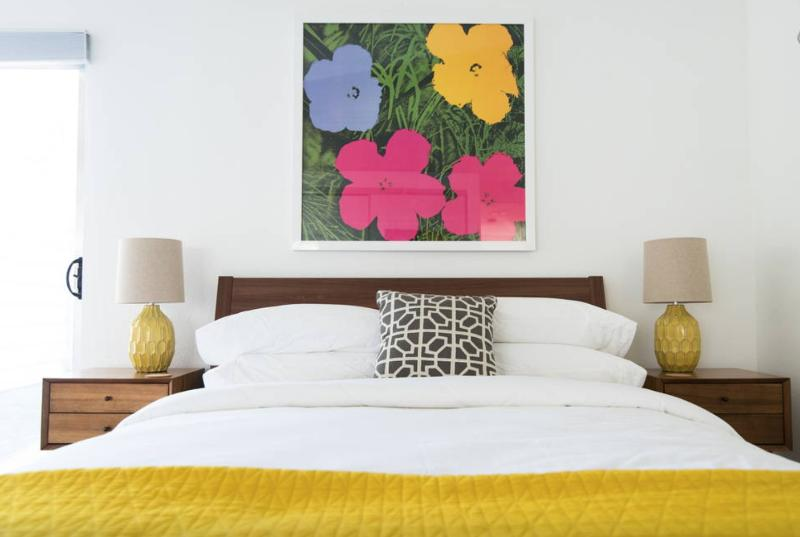 mid century modern bedroom with yellow