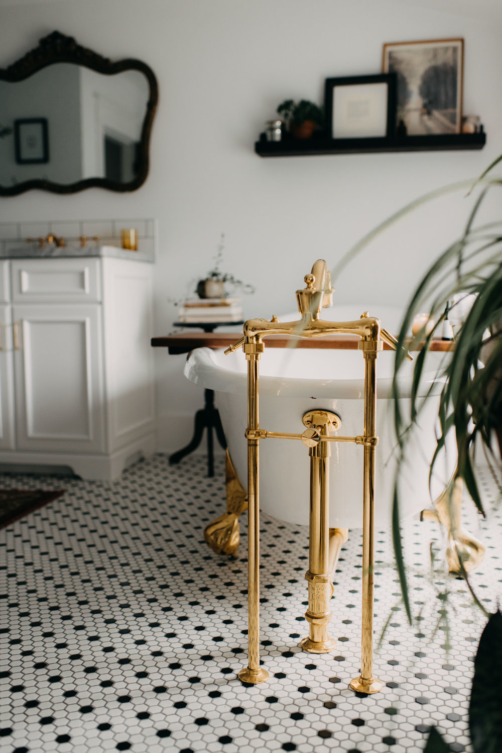clawfoot tub with brass fixtures