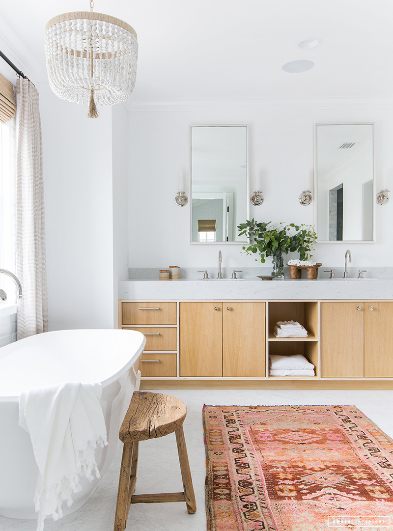 white bathroom with light wood vanity
