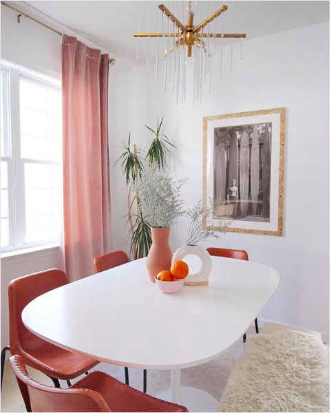 blush dining room with orange and brass accents