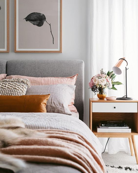 modern bedroom with blush and orange accents