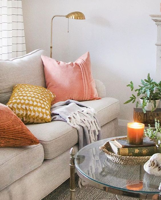 how to pair warm colors with a grey sofa