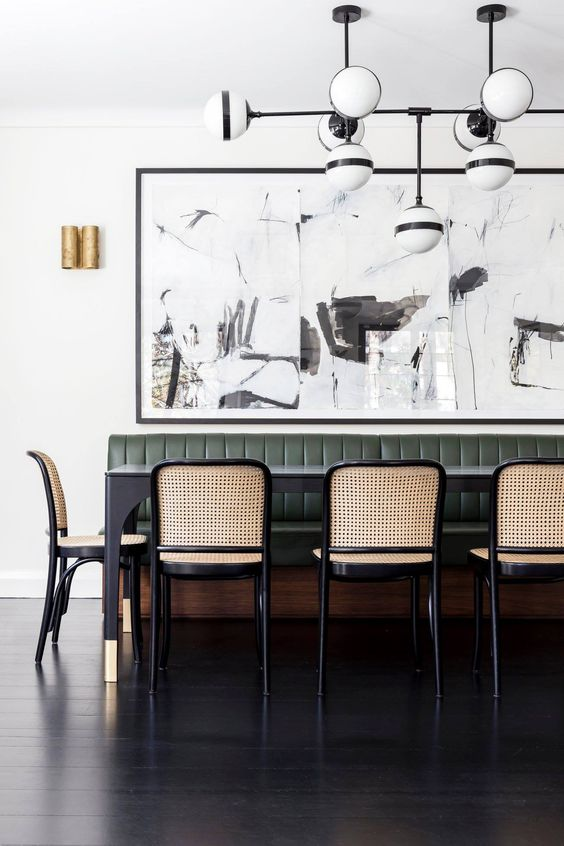 modern dining space with banquette and caned chairs