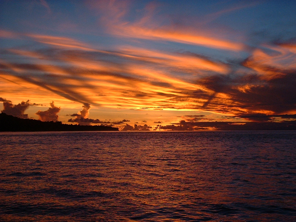 photo:  Andy Bruner, shipboard sunset, Solomon Islands, 2002