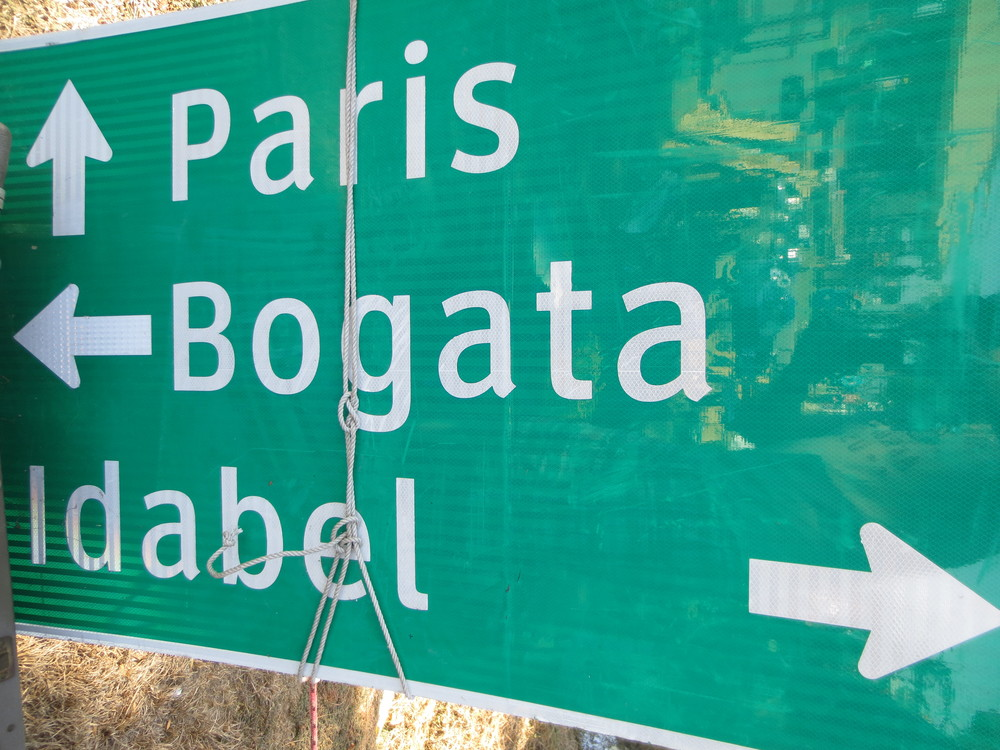 I wish I knew the geographical location where Paris, Bogata, and Idabel all are within a reasonable distance. . .  bumble geography, that's what this sign represents.