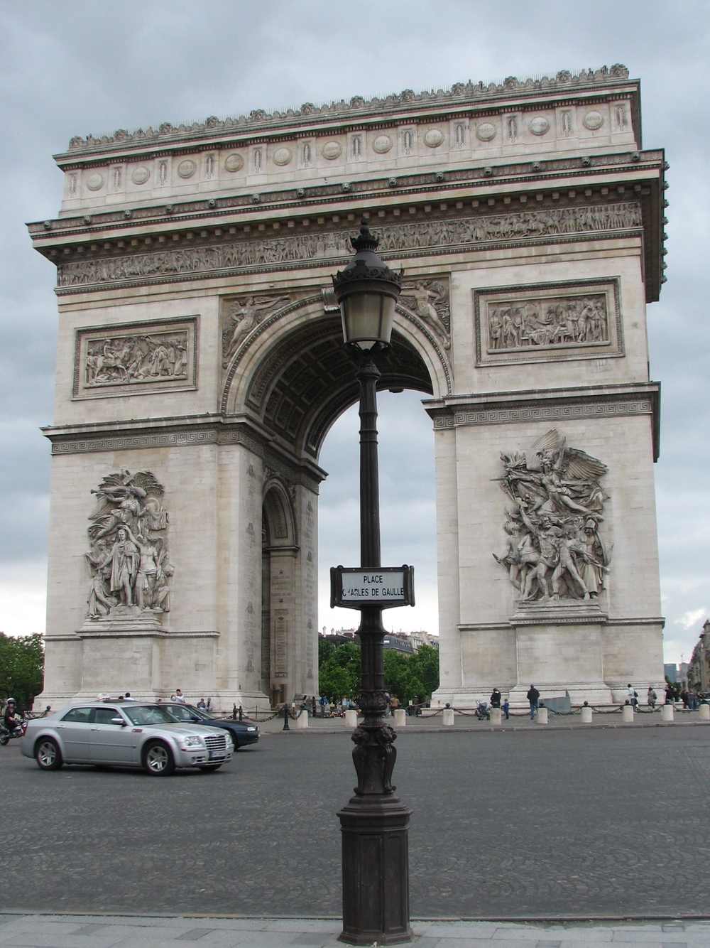 THE ARC DE TRIOMPHE LULLING NEARBY PEDESTRIANS INTO A FALSE SENSE OF SECURITY.
