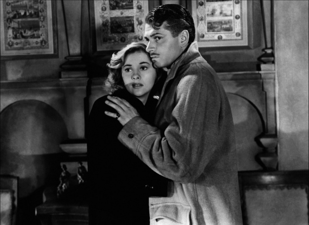 Joan Fontaine and Laurence Olivier in Alfred Hitchcocks noir thriller Rebecca (1940).