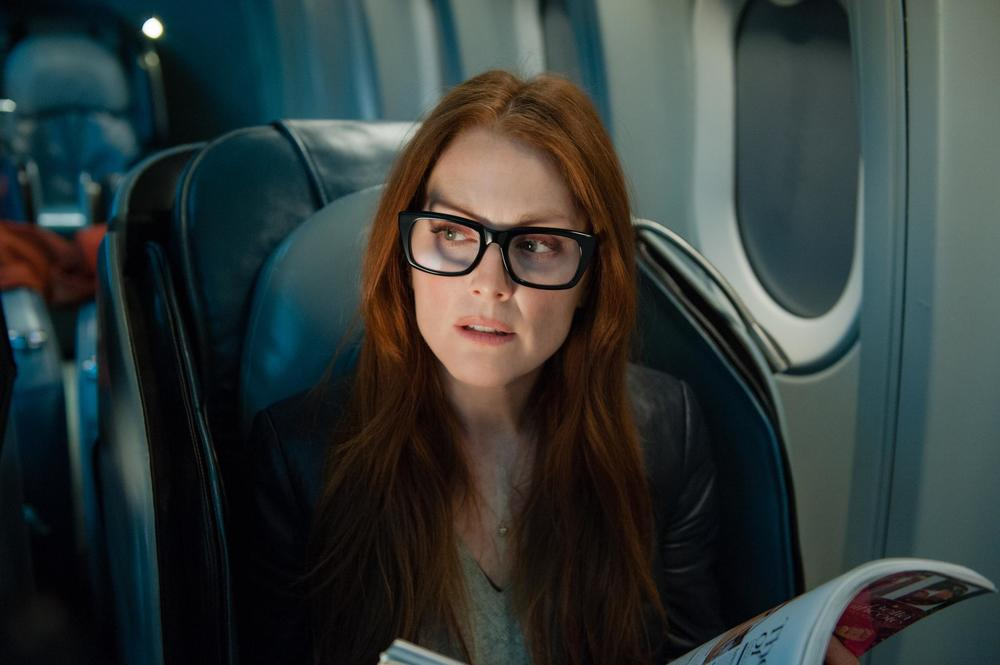 Julianne Moore (above), Lupita Nyong'o (below), and Michelle Dockery (not pictured) portray hollow characters with earnest in Liam Neeson action vehicle Non-Stop (2014).