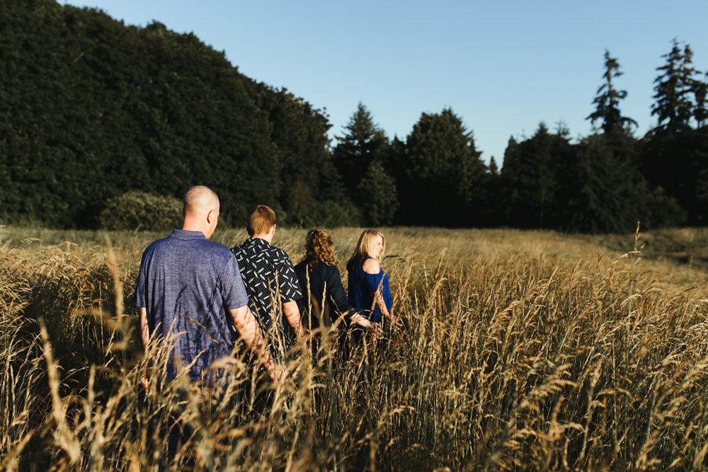 family of four in field