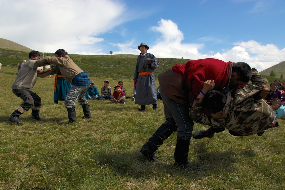 No wedding in Mongolia is complete without a mini Naadam, guests and 2 sides of the family compete in a friendly wrestling tournament in the honor of the newlyweds.