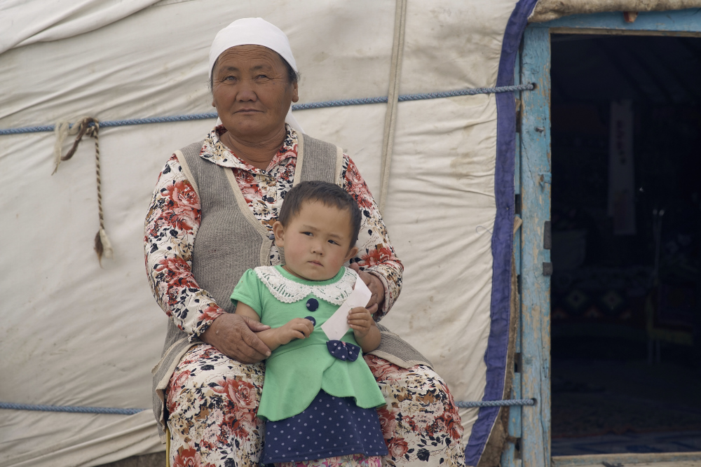 Love of his life and one of his granddaughter's outside his ger enjoying gentle summer breeze. Captured in Sagsai, Mongolia.