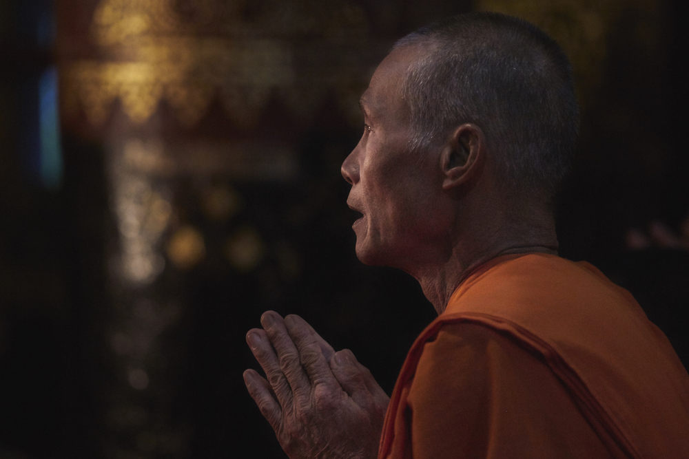 Khasar_S_PrayingMonk_LuangPrabang_Laos_Winter_2014.jpg