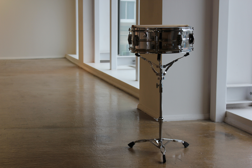 100,000 BPY. Snare drum, laser engraved text, drum sticks