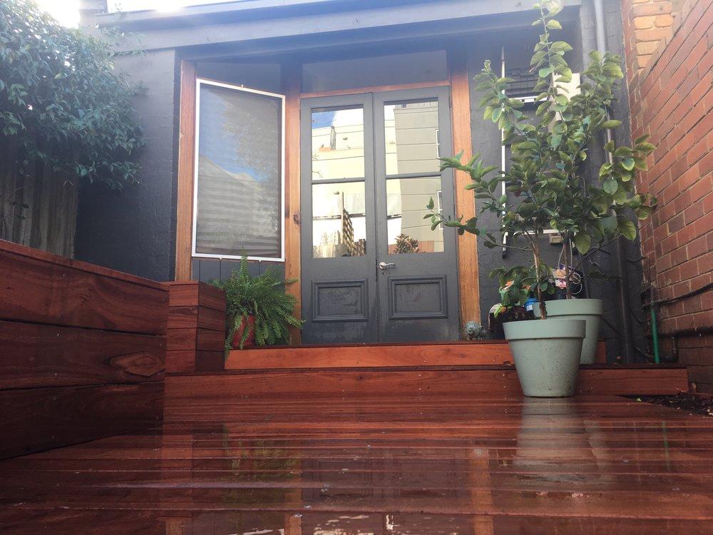 Carlton Courtyard. Jarrah Decking. Citrus Pots. Raised Vegetable Garden. Wet Day.