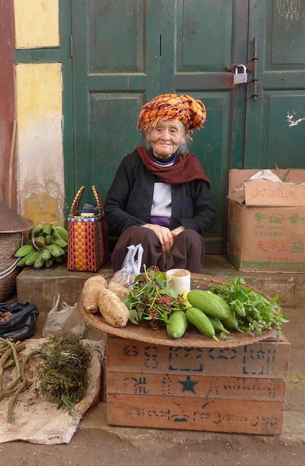 The tribal people who come in to sell their produce all wear lovely colourful head scarfs.