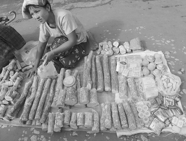 A girl selling tanaka.