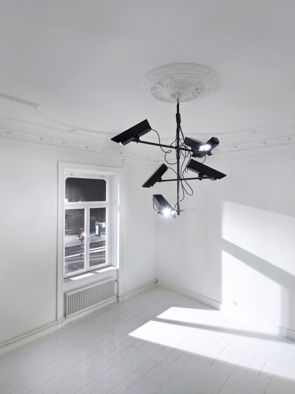 Surveillance Light Chandelier, 2011 Chandelier with camera houses as light spots.