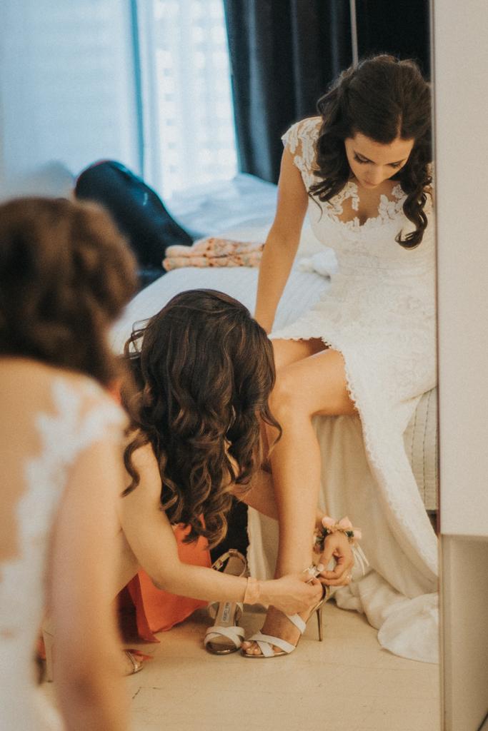 bride puts shoes