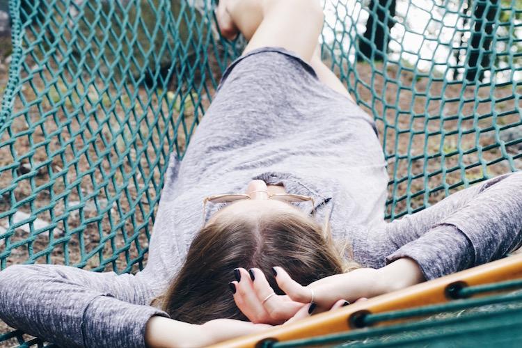 Jill Lansky seen wearing the Jacquetta Henley Sleepwear Tunic in purple mix laying on a hammock
