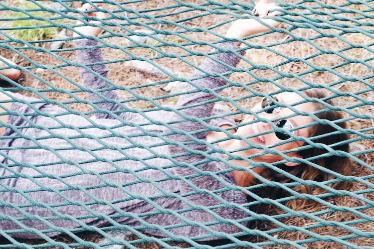 Jill Lansky seen wearing the Jacquetta Henley Sleepwear Tunic in purple mix under the hammock