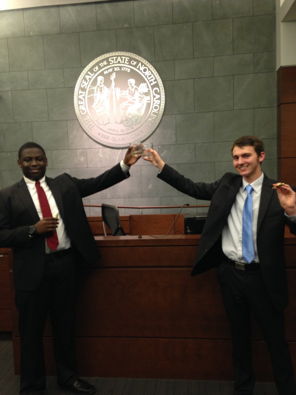 All-American Redirects competitors Imokhai Okolo and Henry Leaman after winning outstanding attorney awards at the Tobacco Road Invitational.
