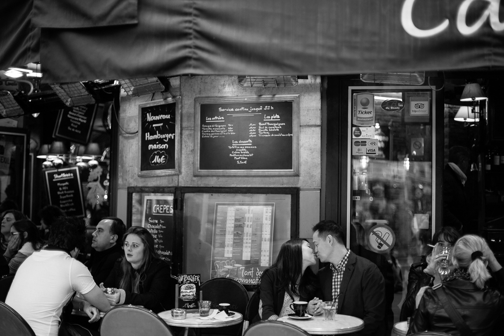 couple in paris cafe kissing.jpg