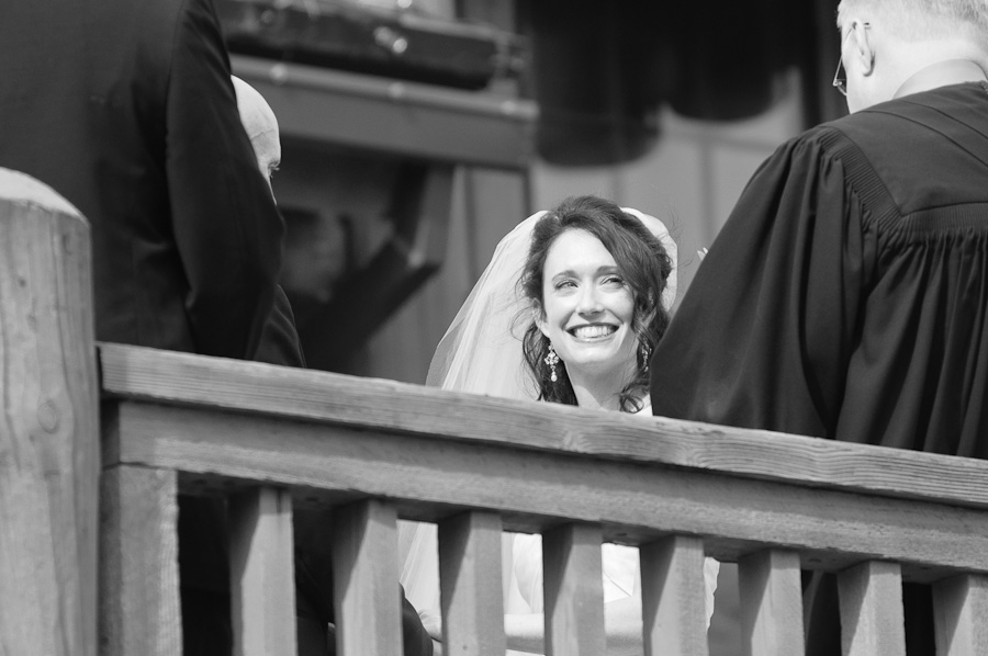 Bride smiling at wedding ceremony on Keystone mountain in black and white