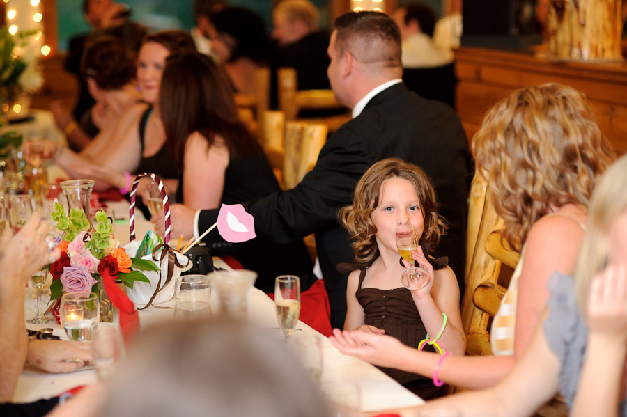 little girl sipping champagne at wedding at Wild Basin Lodge in Roosevelt National Forest Colorado
