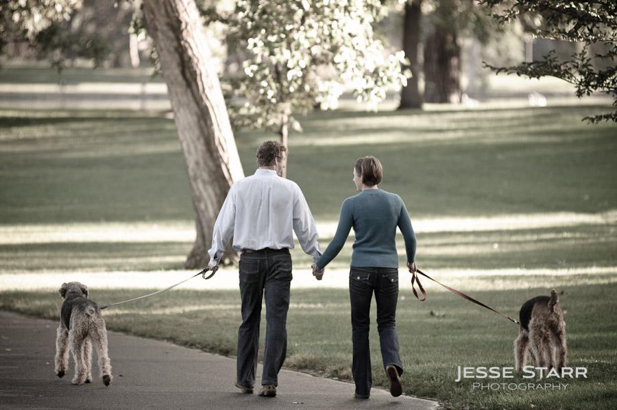 couple walking dogs in wash park, colorado