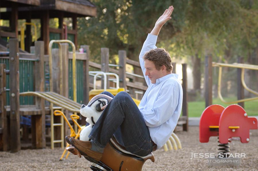 man playing on rocking horse at playground